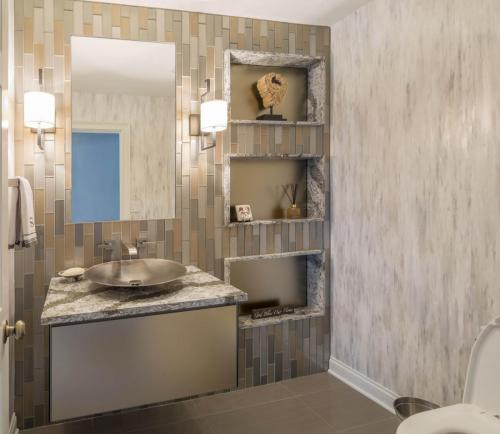 Contemporary Glass and Metallic Powder Room